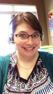 Amelia wearing a headset