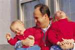 Dad with laughing kids