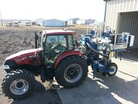 Tractor and planter used for establishing corn hybrid plots