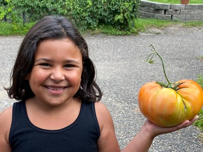 Girl with tomato