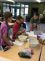 Youth learn cooking skills at the North Dakota 4-H Camp. (NDSU photo)
