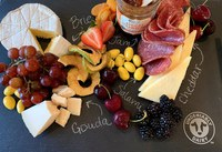A cheese board has a range of cheese, meat, vegetables, fruits and grain items on the side. (Photo courtesy of Midwest Dairy)