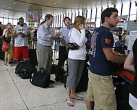 Long lines at the airport can cause stress that affects your eating patterns.