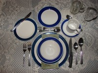 A formal table setting may include a lineup of utensils and glasses. (Photo courtesy of Jessalrene, Morguefile)