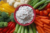 This spinach dip makes use of some of summer's bounty, the super-nutritious green veggies spinach and kale, along with carrots and bell peppers. (NDSU photo)