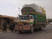 Afghan Truck hauling agricultural products.