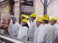 Producers tour a lamb meat packing plant.