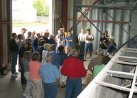 Producers tour the feed mill at the Carrington Research Extension Center.