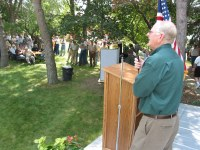 """NDSU President Joseph Chapman addresses the audience during last year's """"""""Conversations Across the Land"""""""" tour."""
