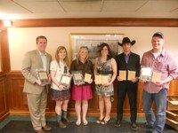 NDSU's meat judging team members display awards they received at the Southeastern Intercollegiate Meat Contest. Pictured are, from left to right: team member Levi Hall; coach Kelsey Phelps; team members Micayla Clarin, Christine Wanner and Mason Lautenschlager; and coach Nathan Hayes.