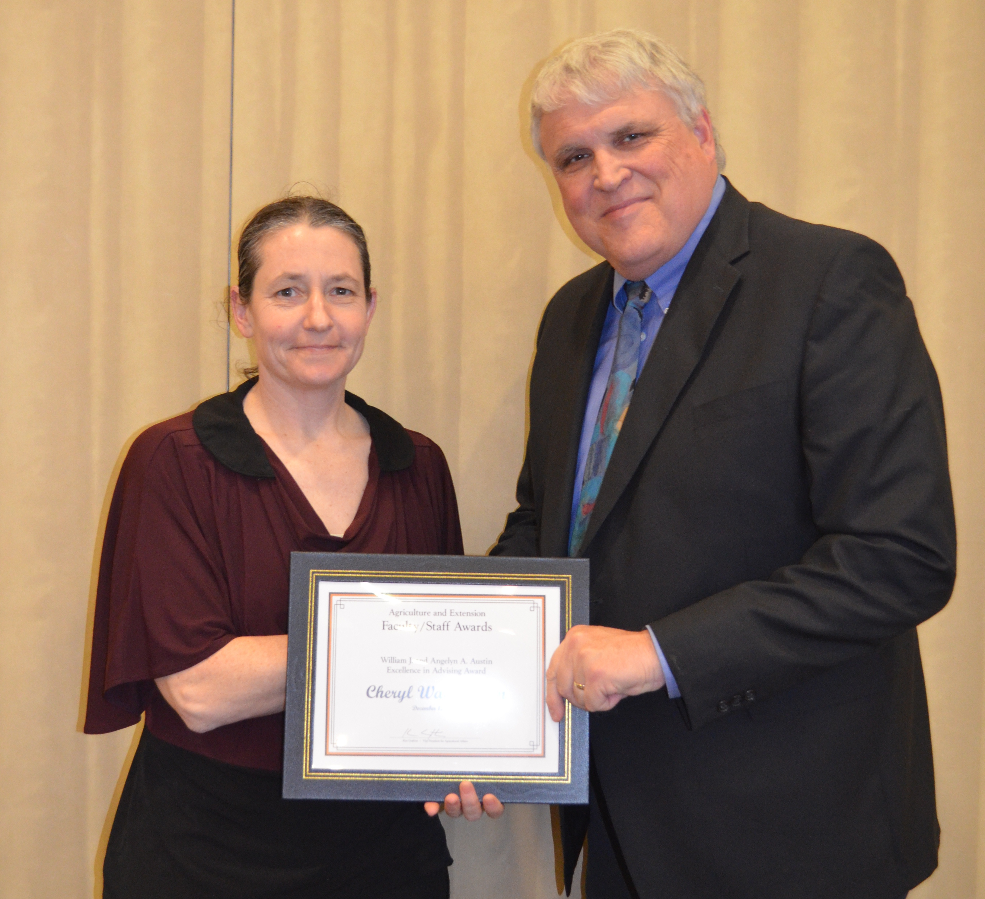 Cheryl Wachenheim, professor, Department of Agribusiness and Applied Economics, receives the William J. and Angelyn A. Austin Excellence in Advising Award from David Buchanan, associate dean for academic programs in the College of Agriculture, Food Systems, and Natural Resources.