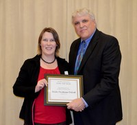 Deirdre Prischmann-Voldseth, assistant professor, School of Natural Resource Sciences (Entomology Department) receives the Earl and Dorothy Foster Excellence in Teaching Award from David Buchanan, associate dean for academic programs in the College of Agriculture, Food Systems, and Natural Resources.
