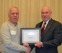 Jim Moos, maintenance mechanic, Department of Agricultural and Biosystems Engineering, left, receives the Rick and Jody Burgum Staff Award from Ken Grafton, vice president for Agricultural Affairs; dean of the College of Agriculture, Food Systems, and Natural Resources; and director of the North Dakota Agricultural Experiment Station.