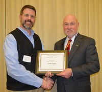 Scott Pryor, associate professor, Department of Agricultural and Biosystems Engineering, left, receives the Larson/Yaggie Excellence in Research Award from Ken Grafton, vice president for Agricultural Affairs; dean of the College of Agriculture, Food Systems, and Natural Resources; and director of the North Dakota Agricultural Experiment Station.