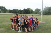 Youth have fun while taking part in a team-building activity at the North Dakota 4-H Camp near Washburn.