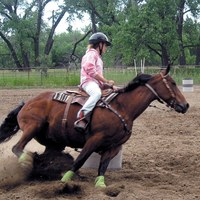 A 4-H'er practices barrel riding during the Barrel and Pole Camp at the North Dakota 4-H Camp near Washburn.