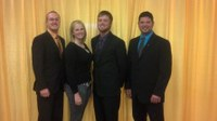 NDSU's dairy judging team returned from the All-American Dairy Show with several awards. Pictured are (from left) team members Eric Miller, Kristi Tonnessen and Brett Blackwelder, and team coach Cole Rupprecht. (NDSU photo)