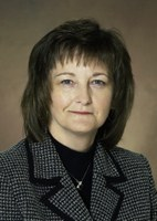 Kathleen Tweeten, director of the NDSU Extension Service's Center for Community Vitality, receives the North Central Region Distinguished Service Award.