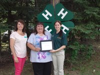 Dorinda Rutschke (center) and Casondra Rutschke (right) receive recognition from Leann Schafer, North Dakota 4-H Foundation Board chair. The Rutschkes are members of the James and LuElla Klein family, which was named a 4-H century family.