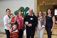 North Dakota 4-H Hall of Fame inductee Larry Leier is surrounded by his family and Leann Schafer, North Dakota 4-H Foundation Board chair (far right). Family members are (from left) daughter Nicole VanderVorst, grandsons Judson and Dawson VanderVorst, wife Rosalind and daughter Marissa Leier.
