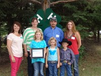 The Hendrickson family is named a 4-H century family. Pictured are (back row from left) North Dakota 4-H Foundation Board Chair Leann Schafer, Lisa Hendrickson, Kevin Hendrickson and Kari (Hendrickson) Risty, and (front row from left) Mackenzie Hendrickson, Sawyer Hendrickson and Kohl Risty.