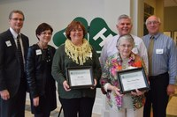 Veronica Davis (front row, right) and her daughter, Joanne Jager (front row, left) are recognized on behalf of their family, which was named a 4-H century family. The others are (from left) Chris Boerboom, NDSU Extension Service director; Donna Anderson, an Extension agent from Foster County; Brad Cogdill, director of the NDSU Extension Center for 4-H Youth Development; and Joel Lemer, an Extension agent for Foster County.