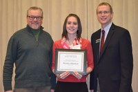 Christina Rittenbach, Extension agent, Stutsman County, receives the Myron and Muriel Johnsrud Excellence in Extension/Outreach Award from Chris Boerboom, director of the NDSU Extension Service (right), and Ron Wiederholt, southeast district director.