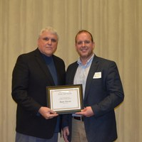 David Buchanan, associate dean for academic programs in the College of Agriculture, Food Systems, and Natural Resources (left), presents Ryan Larsen, assistant professor, Department of Agribusiness and Applied Economics, with the Earl and Dorothy Foster Excellence in Teaching Award.