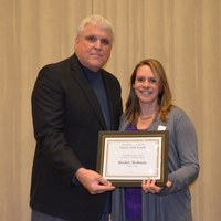 David Buchanan, associate dean for academic programs in the College of Agriculture, Food Systems, and Natural Resources, presents Rachel Richman, senior lecturer, Department of  Veterinary and Microbiological Sciences, with the H.Roald and Janet Lund Excellence in Teaching Award.