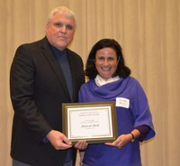 David Buchanan, associate dean for academic programs in the College of Agriculture, Food Systems, and Natural Resources, presents Marisol Berti, associate professor, Department of Plant Sciences, with the Larson/Yaggie Excellence in Research Award.