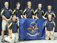 The North Dakota 4-H shooting sports team places 11th overall at the National 4-H Shooting Sports Invitational in Grand Island, Neb. Pictured are (back row, from left): Coach Greg Eider, team member alternate Blake Hensley, team members Quaid Larsen and Skyler Bitz, and Coach Jeff Ellingson; (front row, from left): team members Jacob Ellingson and Jade Ellingson.