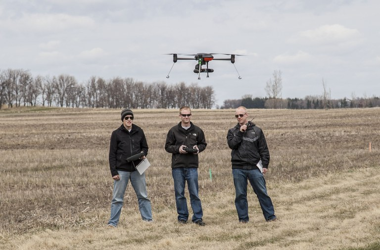 Jakee Stoltz (left), Trevor Woods (center) and Logan Lass of UND's Center for Unmanned Aircraft Systems Research, Education and Training are conducting a test flight of an unmanned aircraft system as part of a research project at NDSU's Carrington Research Extension Center. (NDSU photo)