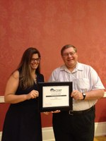 Glenn Muske, NDSU Extension rural and agribusiness enterprise development specialist, receives the Distinguished Service Award from National Association of Community Development Extension Professionals' President Alison Davis.