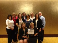 Kathy Tweeten, director of the NDSU Extension Center for Community Vitality; and Extension agents Jodi Bruns and Helen Volk-Schill are members of a tri-state team that received the first-place award in the Excellence in Teamwork category at the National Association of Community Development Extension Profesionals' conference. Picutred are (back row, from left): Charlotte Narjes of Nebraska, Dave Olson of South Dakota, Bruns and Kenneth Sherin of South Dakota; (center row): Peggy Schlechter of South Dakota, Rebecca Vogt of Nebraska, Kari O'Neill of South Dakota and Tweeten; (seated): Connie Hancock of Nebraska and Becky Bowan, former economic development director in Underwood.