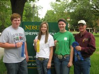Oliver County team members (from left) Shane Giedd, Rachel Oliver and Emily Klein, and their coach, Extension agent Rick Schmidt, display ribbons the team received in the senior division of the 4-H dairy judging contest at NDSU.