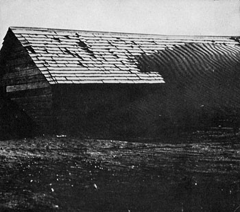 Soil dunes over a barn in Kidder County (1939). N.D. State Archives image.