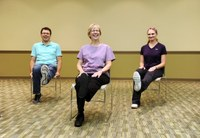 These adults are practicing some stretching exercises to strengthen their muscles and improve their flexibility. The exercises are part of the Nourish Your Muscles lesson in the NDSU Extension Service's Nourishing Boomers and Beyond Program. (NDSU photo)