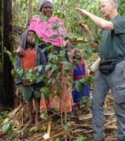 NDSU Extension agronomist Hans Kandel explains pruning to coffee growers in Uganda. (NDSU photo)