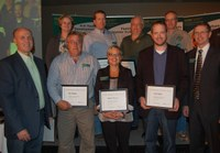 Patrick Sitter, general manager of Farm and Ranch Guide, and Chris Boerboom, NDSU Extension director, present a Program Excellence Award to this team for developing a program to evaluate the sustainability of beef cattle breeding systems. Pictured are (front row, left to right) Sitter; Ron Haugen, Extension farm management specialist; Andrea Bowman, Extension agent, agriculture and natural resources, Bowman County; Carl Dahlen, Extension beef cattle specialist; Boerboom; (back row, left to right) Penny Nester, Extension agent, agriculture and natural resources, Kidder County; Brian Zimprich, Extension agent, agriculture and natural resources, Ransom County; Craig Askim, Extension agent, agriculture and natural resources, Mercer County; Rick Schmidt, Extension agent, agriculture and natural resources, Oliver County (NDSU photo)