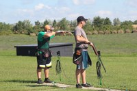 Ramsey County team members Dylan Durbin, left, and Bryer Erickson compete in the 2016 North Dakota 4-H Shooting Sports State Shotgun Match. (NDSU photo)