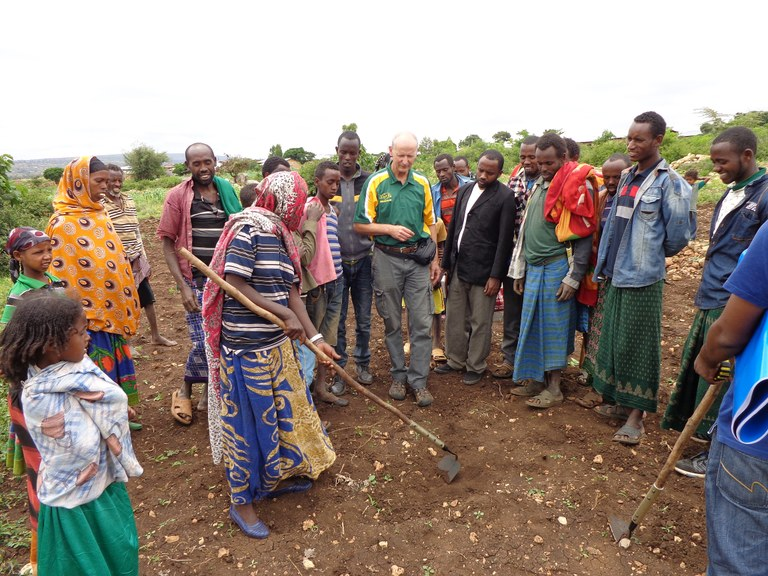 Kandel demonstrates the use of a long-handled hoe, brought from the U.S. to the Iftu village in Ethiopia. (NDSU Photo)