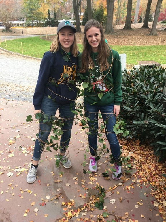 North Dakota 4-H'ers Marit Wang, left, and Avery Breiland remove an invasive species of ivy at the Atlanta History Museum as a community service project that was part of the National 4-H Congress activities. (NDSU photo)