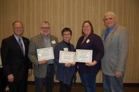 NDSU faculty were honored for their teaching and advising during the 25th annual Agriculture and Extension Faculty/Staff Awards program Dec. 8. Pictured are, from left, NDSU President Dean Bresciani; R.Jay Goos, professor, School of Natural Resource Sciences (Soil Science); Shelly Swandal, student services director, Department of Agribusiness and Applied Economics; Christina Hargiss, assistant professor, School of Natural Resource Sciences (Natural Resources Management); and David Buchanan, associate dean for academic programs in the College of Agriculture, Food Systems, and Natural Resources. (NDSU photo)