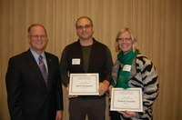 NDSU researchers were honored during the 25th annual Agriculture and Extension Faculty/Staff Awards program Dec. 8. Pictured are, from left, NDSU President Dean Bresciani; Robert Brueggeman, associate professor, Department of Plant Pathology; and Kimberly Vonnahme, professor, Department of Animal Sciences. (NDSU photo)