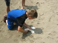 """Cooper Stommen of Fort Rice makes a """"""""fossil"""""""" as part of his outdoor adventures at the North Dakota 4-H Camp. (Stommen family photo)"""