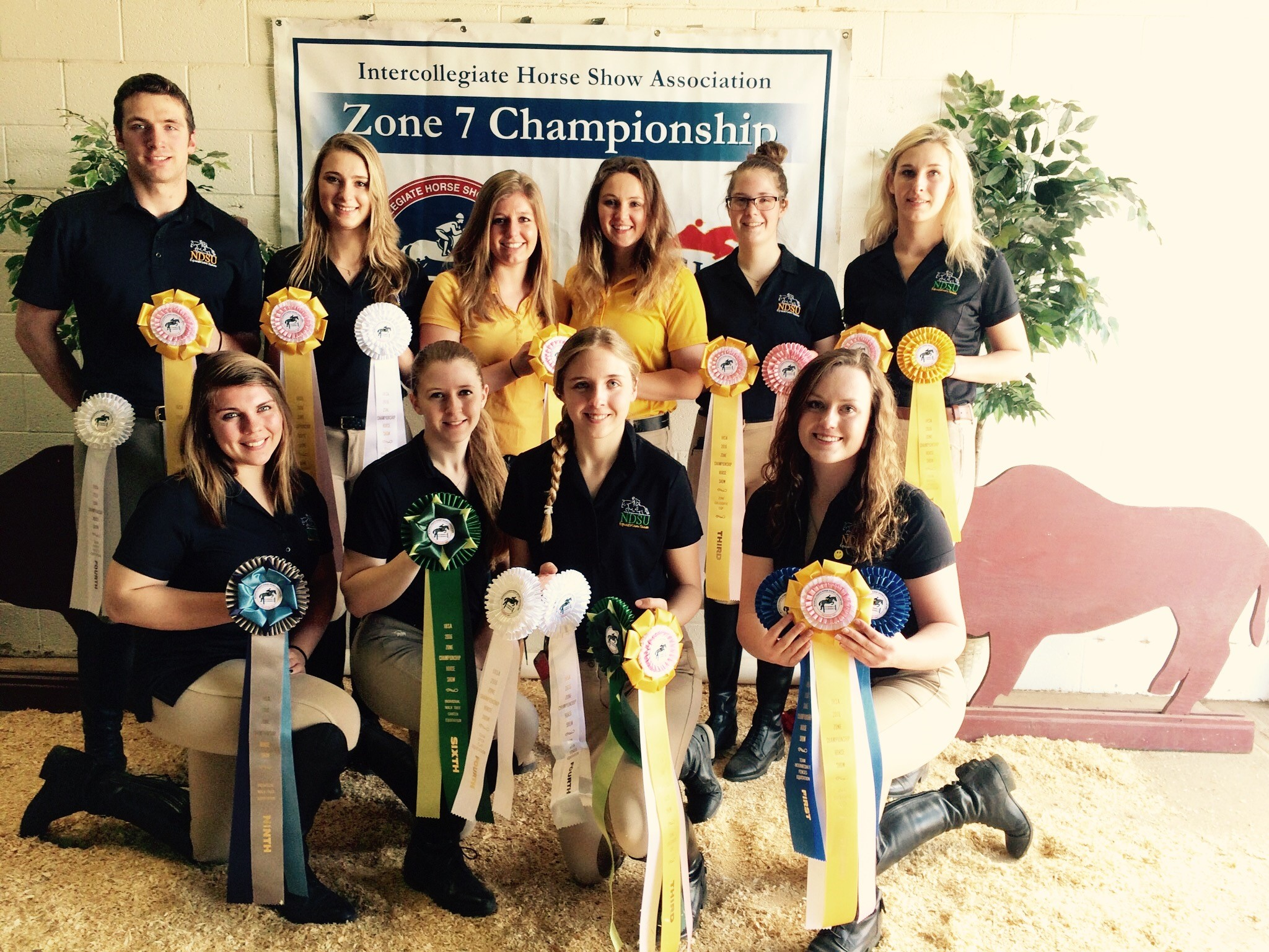 The NDSU hunt seat equestrian team takes third place in zones comeptition hosted by West Texas A&M. Pictured are, from left, front row: Bryn Halley, Hailey Aagard, Kayla Young and Morgan Samuelson; back row: Nick Scarberry, Bridget Kackos, Mattia Gunkelman, Rebecca Prasch, Emma Ballard and Dana Williams. (Photo courtesy of Mattia Gunkelman)