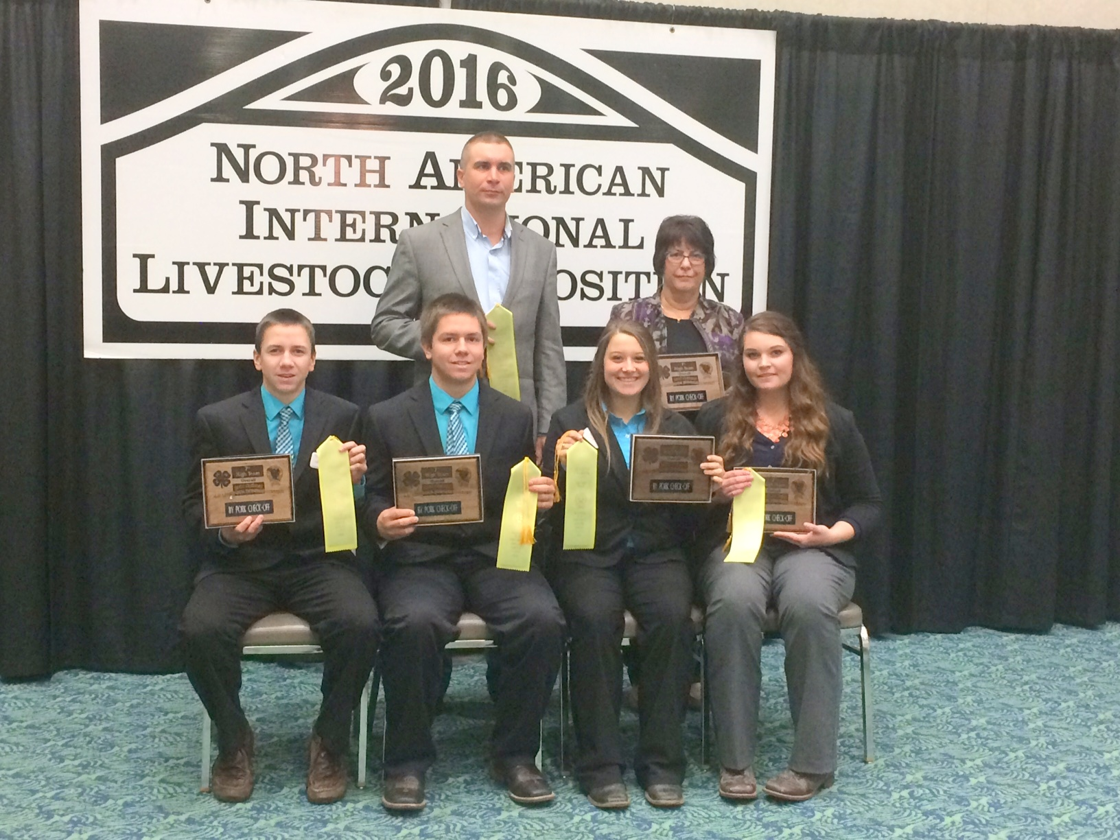 Morton County's team places seventh overall in the National 4-H Livestock Judging Contest in Louisville, Ky. Pictured are (from left, front row) team members Stetson Ellingson, Jameson Ellingson, Kelsie Jo Schaff and Sara Jochim and (back row) coaches Luke Keller and Jackie Buckley. (NDSU photo)