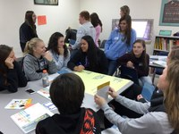 Student council members from schools in Ashley, Linton and Napoleon participate in a Real Colors activity during a Youth Lead Local event in Napoleon. (NDSU photo)
