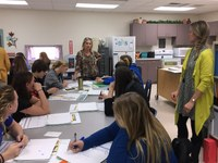 Sue Quamme, NDSU Extension 4-H youth development specialist (center) and Caroline Homan, an Extension agent from LaMoure County (right), work with youth during a Youth Lead Local event in Napoleon. (NDSU photo)