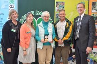 Barb Rice of Maddock, center, receives North Dakota's Outstanding Lifetime 4-H Volunteer Award for 2016. Pictured with her are (from left) Tammy Meyer, chair of the North Dakota 4-H Foundation board; Kimberly Fox, NDSU Extension Service family and consumer sciences and Family Nutrition Program agent for Benson County; Scott Knoke, Extension's agriculture and natural resources agent for Benson County; and Chris Boerboom, NDSU Extension director. (NDSU photo)
